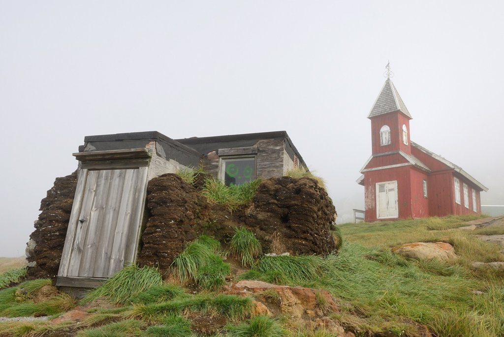 Greenland, Upernavik, Traditional turf house and old church : Stock Photo