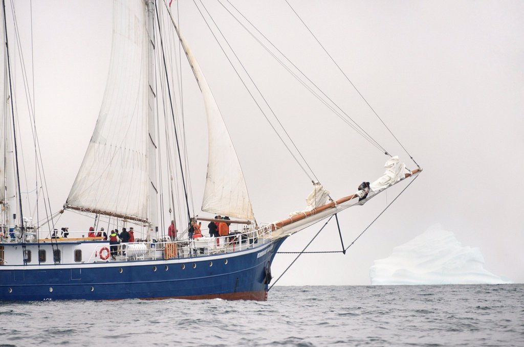 Stock Photo: 1566-1150945 Greenland, Melville Bay, Cape York, Schooner Rembrandt Van Rijn cruising along a 50 m high iceberg
