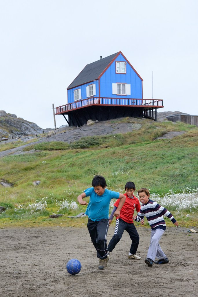 Greenland, Baffin Bay, Tasiusaq, Inuit children playing fooball : Stock Photo