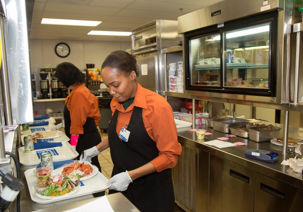 Stock Photo: 1566-1150999 West Bloomfield, Michigan - Crystal Boykin right and Sandy Schwarze prepare lunch trays for hospital patients in the kitchen of Henry Ford West Bloomfield Hospital