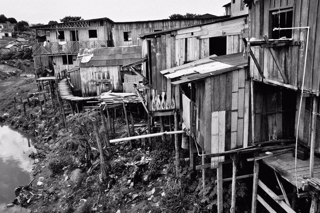 A poor shanty town of Manaus, Brazil  The living standards in the poor neighborhoods of Manaus are similar to those in the other South American mega-cities  Amazonia is the world´s largest dense tropical forest area  Since the 16th century the original in. A poor shanty town of Manaus, Brazil  The living standards in the poor neighborhoods of Manaus are similar to those in the other South American mega-cities  Amazonia is the world´s largest dense tropical forest area  Since the 16th century the : Stock Photo