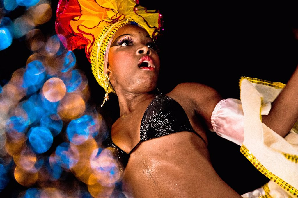 Stock Photo: 1566-1152914 A Cuban girl dances a sexually provocative salsa during the Carnival in Santiago de Cuba, Cuba, 26 July 2008  Carnival in Santiago de Cuba is a large public celebration which is held - contrary to the other Latin American carnivals - in the summer  The ca. A Cuban girl dances a sexually provocative salsa during the Carnival in Santiago de Cuba, Cuba, 26 July 2008  Carnival in Santiago de Cuba is a large public celebration which is held - contrary to the other Latin American carnivals - in the su