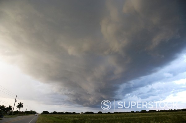 arcus cloud shelf cloud formation preceding a thunderstorm on farmland near the florida everglades usa : Stock Photo