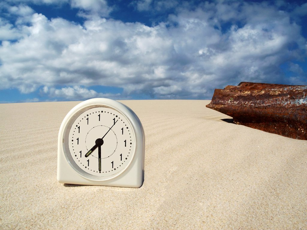 Stock Photo: 1566-1154867 nightmare clock with rusty corrugated iron on sand