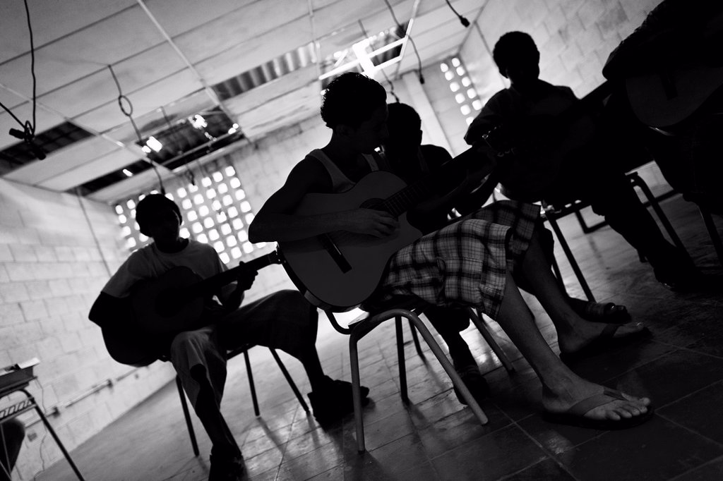 Members of the Mara Salvatrucha gang MS-13 play guitar during the resocialization classes in the prison of Tonacatepeque, El Salvador, 18 May 2011  During the last two decades, Central America has become the deadliest region in the world that is not at wa. Members of the Mara Salvatrucha gang MS-13 play guitar during the resocialization classes in the prison of Tonacatepeque, El Salvador, 18 May 2011  During the last two decades, Central America has become the deadliest region in the world that  : Stock Photo