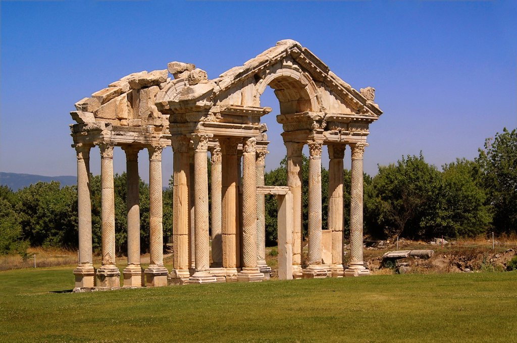 Stock Photo: 1566-1156322 Turkey- Tetrapylon at Aphrodisias Greek: fds, Aphrodisiás was a small city in Caria, on the southwest coast of Asia Minor  Its site is located near the modern village of Geyre, Turkey, about 230 km 140 mi south-east of Izmir and about 100 km 62 mi inland. Turkey- Tetrapylon at Aphrodisias Greek: fds, Aphrodisiás was a small city in Caria, on the southwest coast of Asia Minor  Its site is located near the modern village of Geyre, Turkey, about 230 km 140 mi south-east of Izmir and about 100 km 62