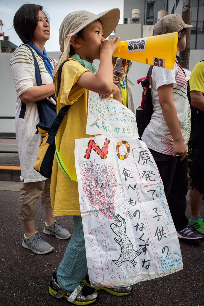 Stock Photo: 1566-1159353 Anti-nuclear demonstration in the center of town near the headquarters of Japan´s Government Kokkai or Diet Tokyo Japan