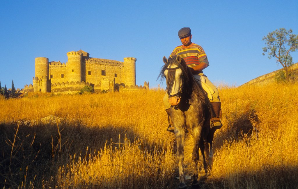 Stock Photo: 1566-1159363 Horseman and Belmonte castle 15th century,Belmonte,Cuenca province,Castilla La Mancha,the route of Don Quixote, Spain