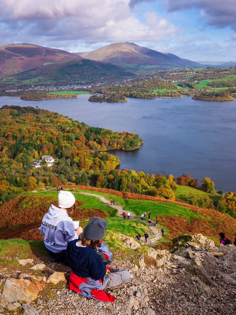 Teenage brother and sister enjoying the view over Derwent Water from Catbells in the Lake District  Keswick, Cumbria, United Kingdom : Stock Photo