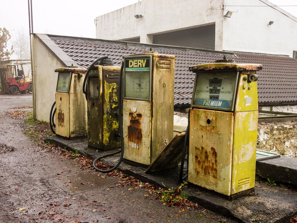 Old style dissused petrol and diesel fuel pumps : Stock Photo