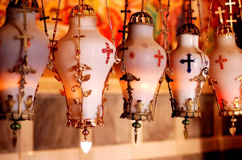 Stock Photo: 1566-1160645 Lamps hang above the Stone of the Anointing in the Church of the Holy Sepulchre, Jerusalem old city, Israel