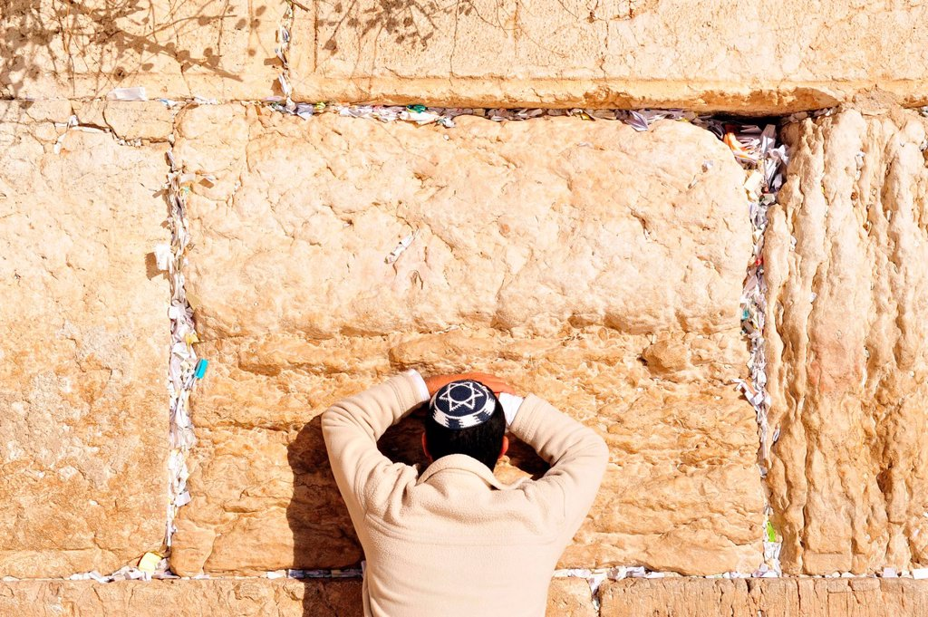 Stock Photo: 1566-1160649 A Jewish man prays at the Western Wall in the old city of Jerusalem, Israel