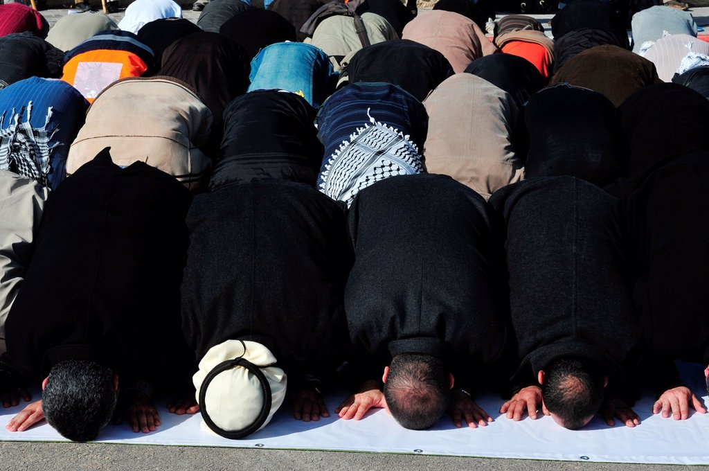 A mass muslim prayer session : Stock Photo
