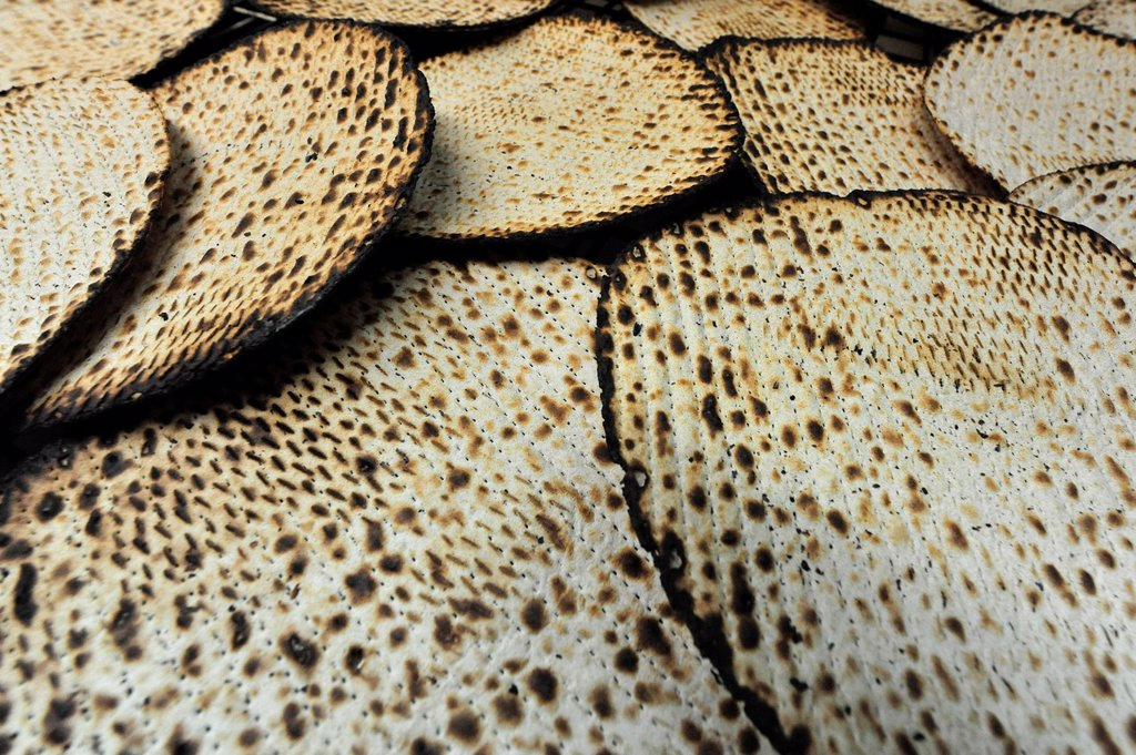 Hand made glatt kosher matzah for the Jewish holiday of Passover : Stock Photo