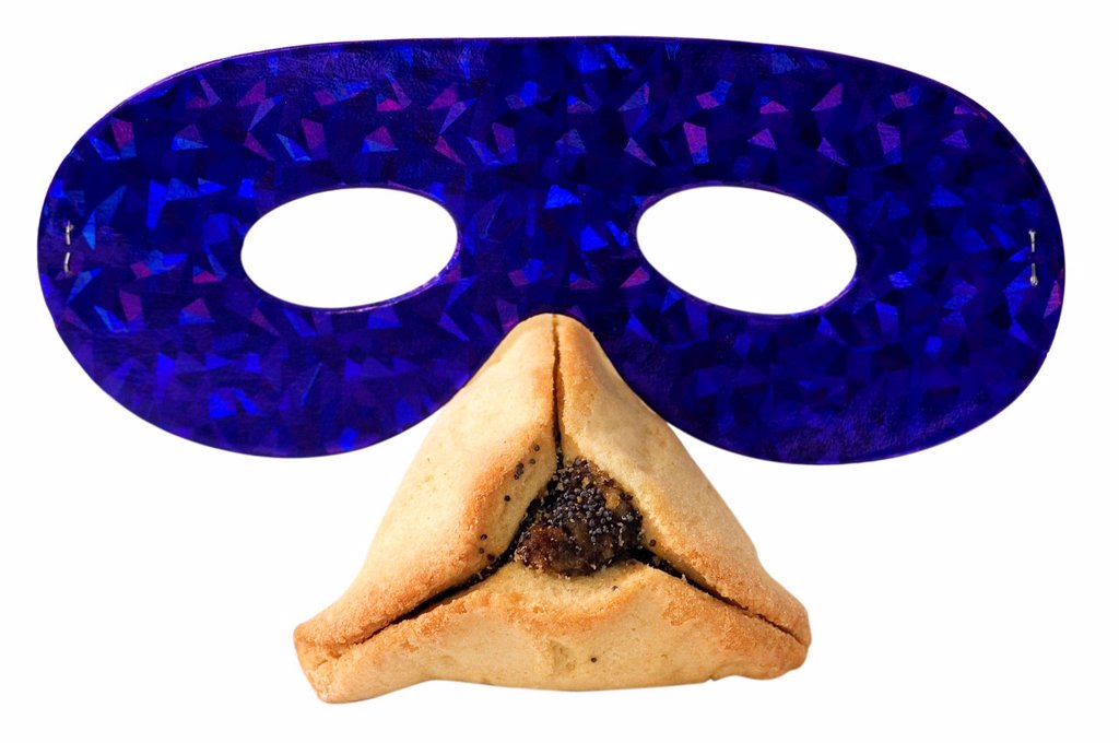 Hamantashen, traditional pastry and a party mask for the Jewish holiday of Purim : Stock Photo