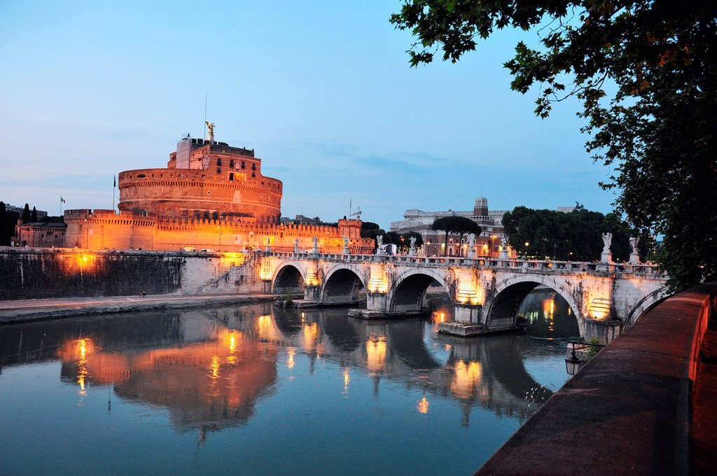 Saint Angelo castle and bridge at night, beautiful old sculptures and lanterns in Rome, Italy : Stock Photo