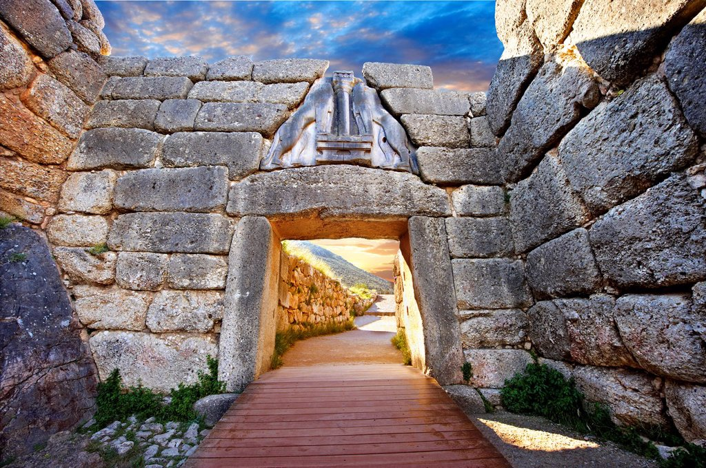 Stock Photo: 1566-1160988 Mycenae Lion Gate & citadel walls built in 1350 B C and known as cyclopean style walls due to the vast size of the blocks it was assumed by visitors in ancientb times that only giant Cycopse could have built them  Excavated by the archaeologist Heinrich S. Mycenae Lion Gate & citadel walls built in 1350 B C and known as cyclopean style walls due to the vast size of the blocks it was assumed by visitors in ancientb times that only giant Cycopse could have built them  Excavated by the archaeologis