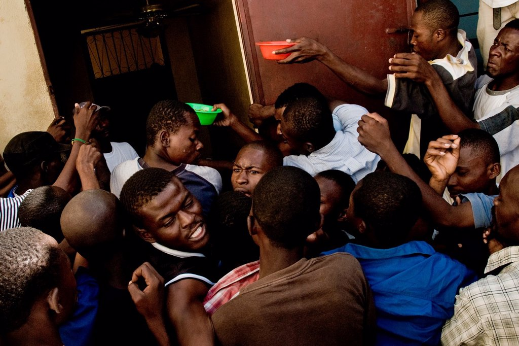 Stock Photo: 1566-1161028 Haitian people fight over food in a food distribution center run by a private Christian organization in Port-au-Prince, Haiti, 8 July 2008  The overall situation on Haiti gets worse every year and the extreme, hardly imaginable poverty hits more and more. Haitian people fight over food in a food distribution center run by a private Christian organization in Port-au-Prince, Haiti, 8 July 2008  The overall situation on Haiti gets worse every year and the extreme, hardly imaginable poverty hits mor