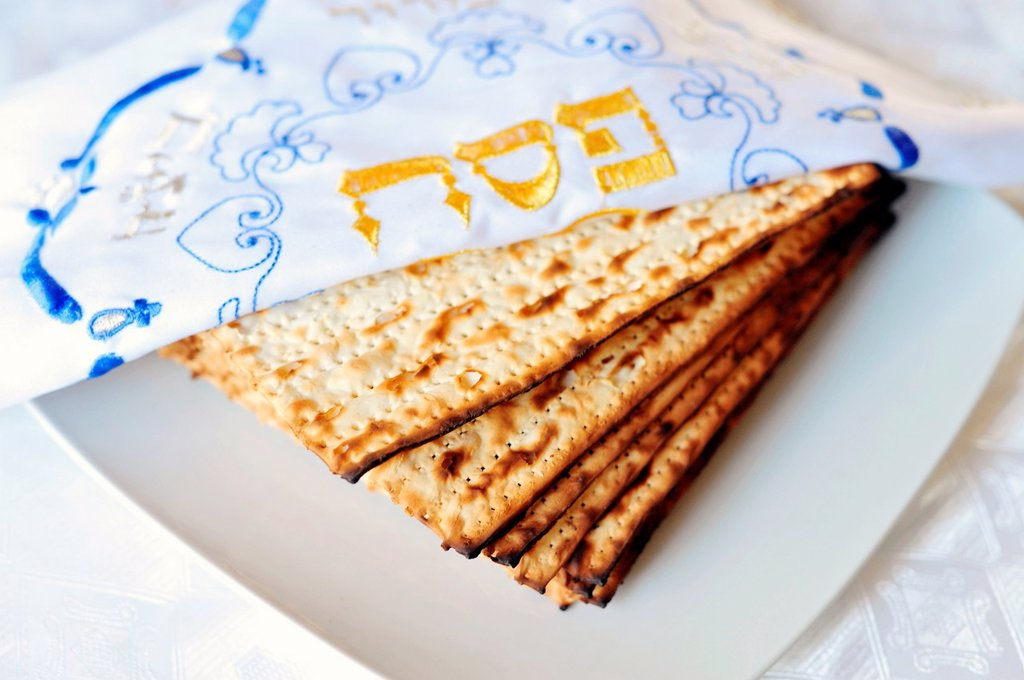 Stock Photo: 1566-1161159 Traditional Jewish Matzo sheet on a Passover Seder table  Passover is a predominantly Jewish holy day and festival  It commemorates the story of the Exodus, in which the ancient Israelites were freed from slavery in Egypt  Passover begins on the 15th day. Traditional Jewish Matzo sheet on a Passover Seder table  Passover is a predominantly Jewish holy day and festival  It commemorates the story of the Exodus, in which the ancient Israelites were freed from slavery in Egypt  Passover begins on th