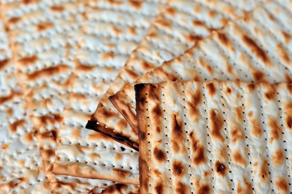 Stock Photo: 1566-1161160 Traditional Jewish Matzo sheet on a Passover Seder table  Passover is a predominantly Jewish holy day and festival  It commemorates the story of the Exodus, in which the ancient Israelites were freed from slavery in Egypt  Passover begins on the 15th day. Traditional Jewish Matzo sheet on a Passover Seder table  Passover is a predominantly Jewish holy day and festival  It commemorates the story of the Exodus, in which the ancient Israelites were freed from slavery in Egypt  Passover begins on th