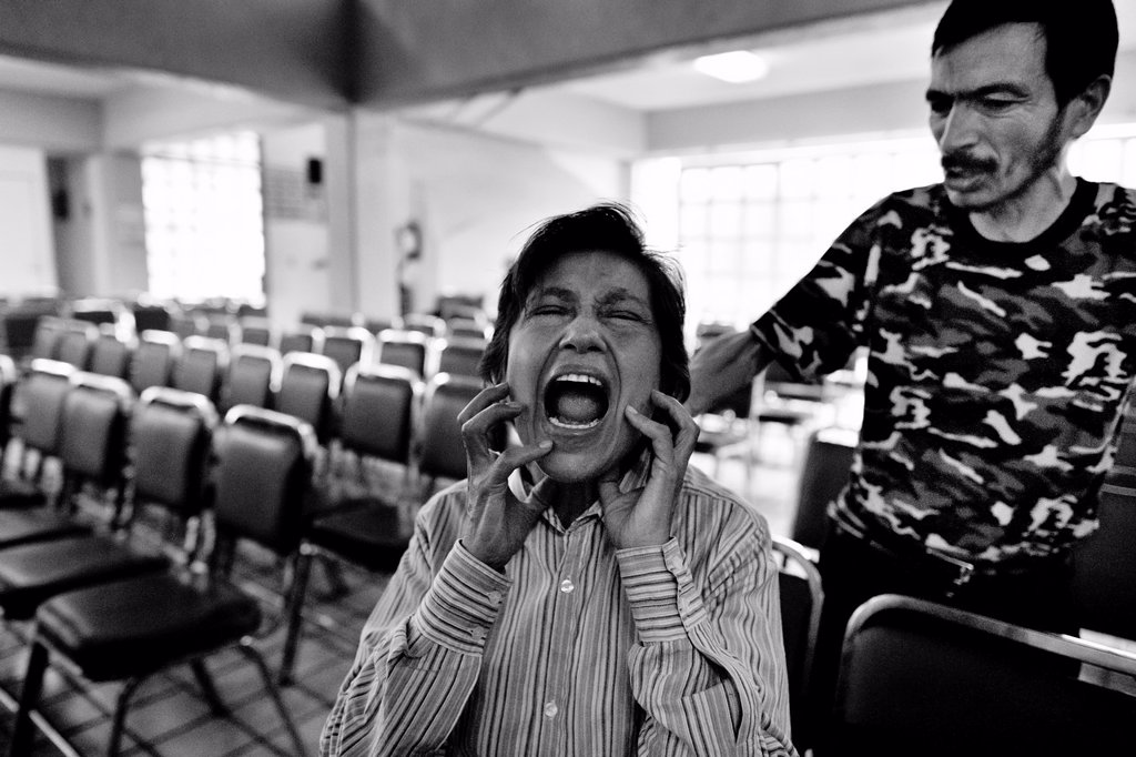 Stock Photo: 1566-1162082 A Mexican woman screams intensively during the exorcism rite performed at the Church of the Divine Saviour in of Mexico City, Mexico, 31 May 2011  Exorcism is an ancient religious technique of evicting spirits, generally called demons or evil, from a pers. A Mexican woman screams intensively during the exorcism rite performed at the Church of the Divine Saviour in of Mexico City, Mexico, 31 May 2011  Exorcism is an ancient religious technique of evicting spirits, generally called demons or evil,
