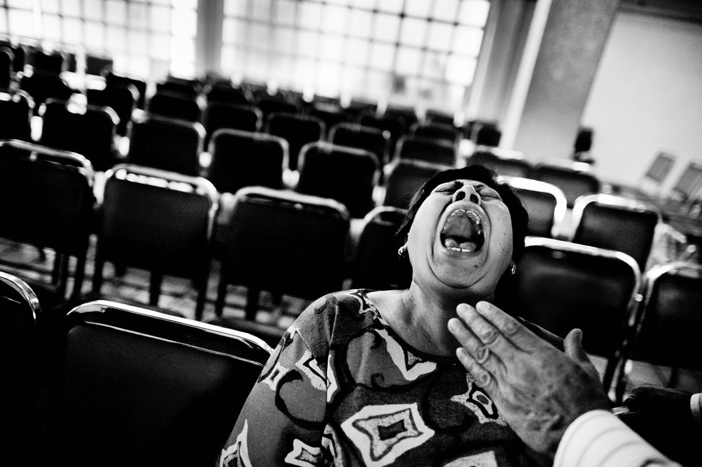 Stock Photo: 1566-1162592 A Mexican woman yells desperately during the exorcism rite performed at the Church of the Divine Saviour in of Mexico City, Mexico, 31 May 2011  Exorcism is an ancient religious technique of evicting spirits, generally called demons or evil, from a person. A Mexican woman yells desperately during the exorcism rite performed at the Church of the Divine Saviour in of Mexico City, Mexico, 31 May 2011  Exorcism is an ancient religious technique of evicting spirits, generally called demons or evil, f