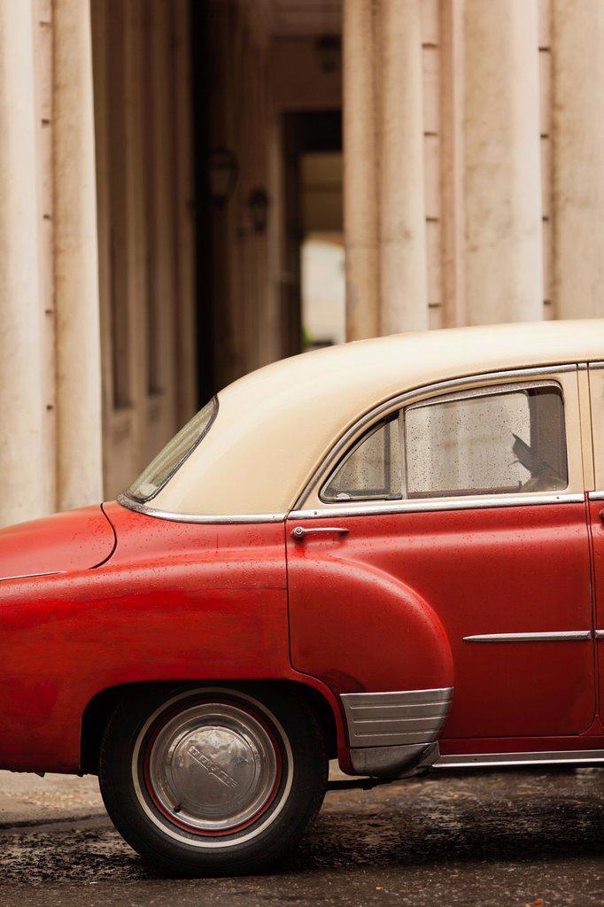 Cuba, Havana, Havana Vieja, morning view of Old Havana street with 1950s-era US car : Stock Photo
