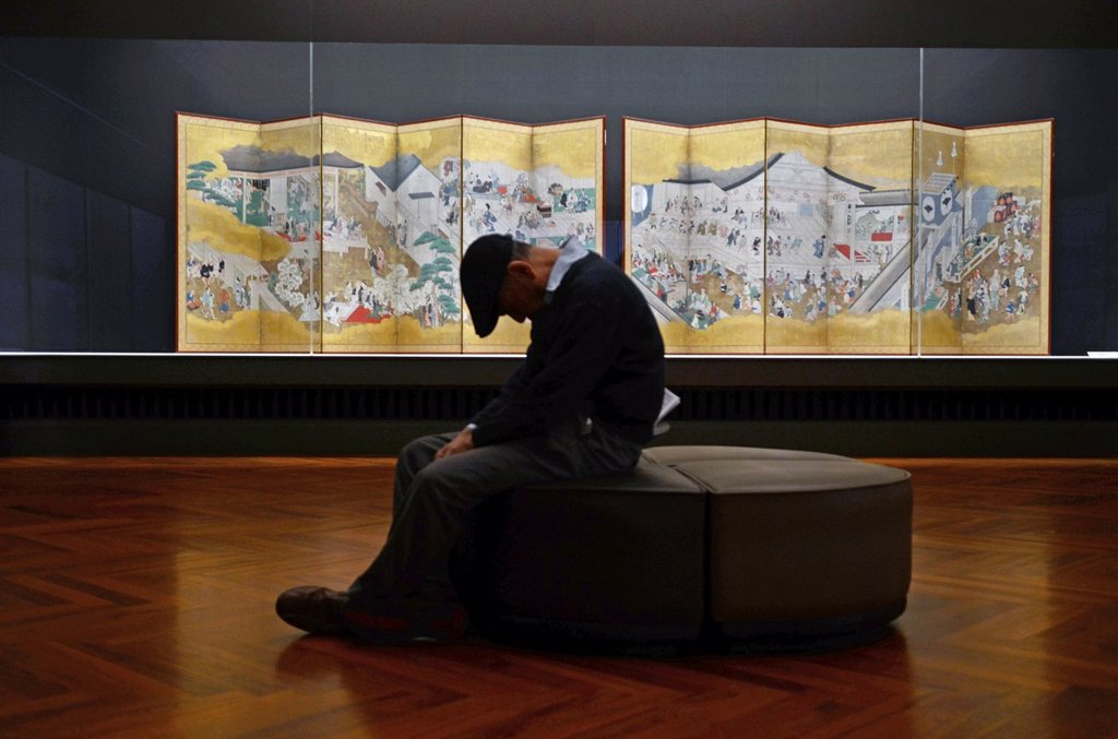 Elderly man falls asleep at Tokyo National Museum or TNM, established in 1872 and the oldest Japanese national museum : Stock Photo