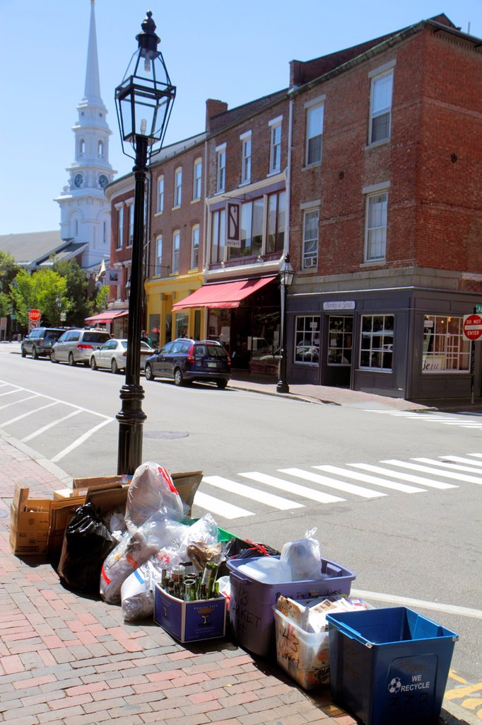 Stock Photo: 1566-1165639 New Hampshire, Portsmouth, Market Street, businesses, trash, containers, curbside, curb, sidewalk, flattened cardboard boxes, plastic bags, North Church,