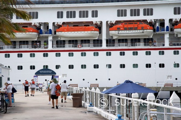 Stock Photo: 1566-1168496 passengers boarding carnival freedom cruise ship moored key west florida usa