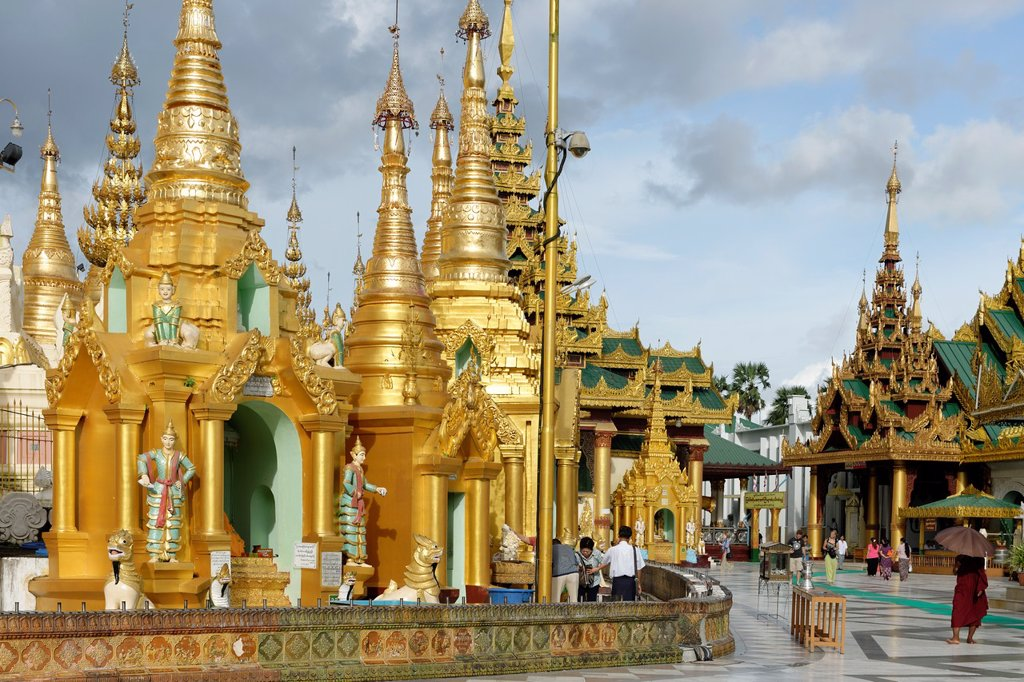 Stock Photo: 1566-1169679 The Shwedagon Pagoda officially titled Shwedagon Zedi Daw also known as the Great Dagon Pagoda and the Golden Pagoda, is a 99 metres  325 ft  gilded pagoda and stupa  It is the most sacred Buddhist pagoda for the Burmese with relics of the past four Buddh. The Shwedagon Pagoda officially titled Shwedagon Zedi Daw also known as the Great Dagon Pagoda and the Golden Pagoda, is a 99 metres  325 ft  gilded pagoda and stupa  It is the most sacred Buddhist pagoda for the Burmese with relics of the pas