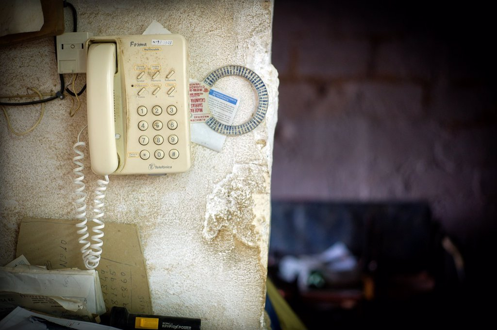 Telefono colgado en la pared, telephone hook on the wall, : Stock Photo