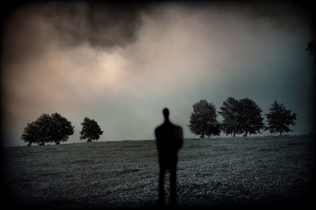 Stock Photo: 1566-1171576 silueta de persona solitaria en un paisaje con árboles, a loner silhouette in a landscape with trees