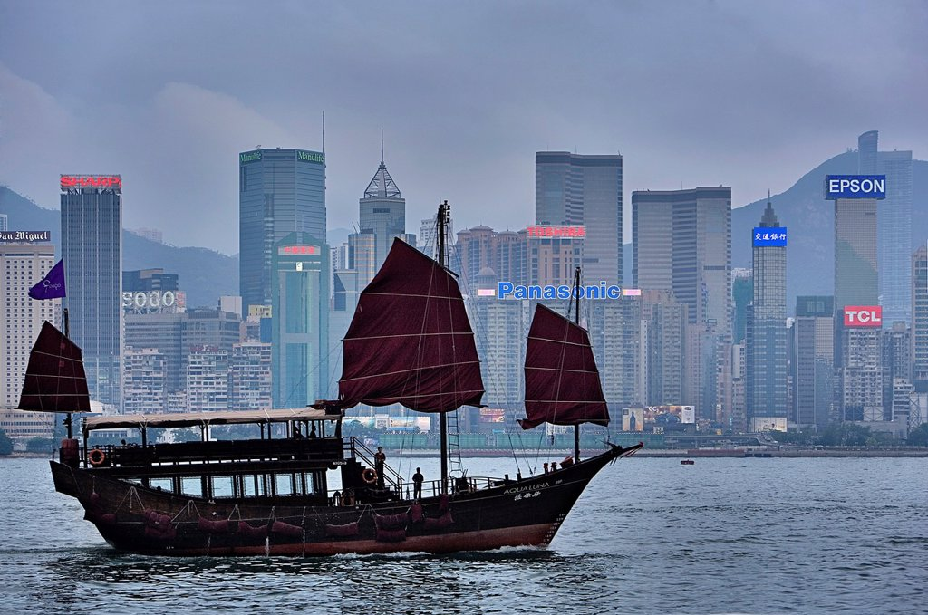 Stock Photo: 1566-1172281 Traditional Sailing boat in Victoria Harbour with City Skyline in the Background,Hong Kong, China