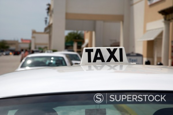 Stock Photo: 1566-1172981 white roof of taxi waiting in a rank outside a shopping mall florida usa