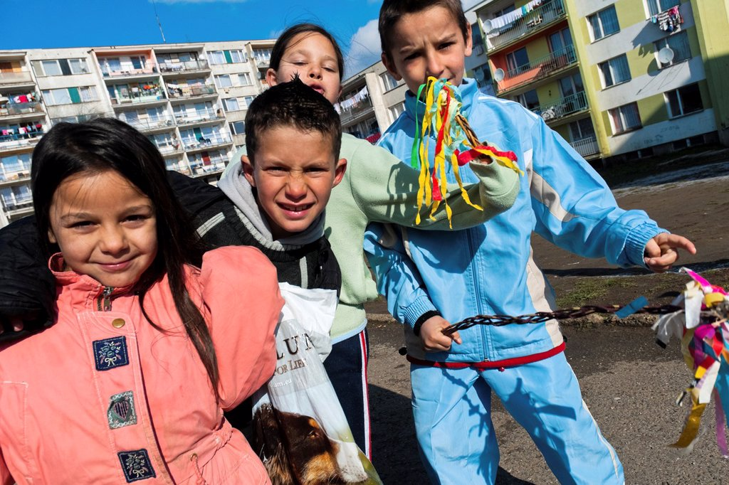 Children, holding their whips made from pussywillow twigs, start the Easter carol in the Gipsy ghetto of Chanov, Most, Czech Republic, 26 March 2008 : Stock Photo
