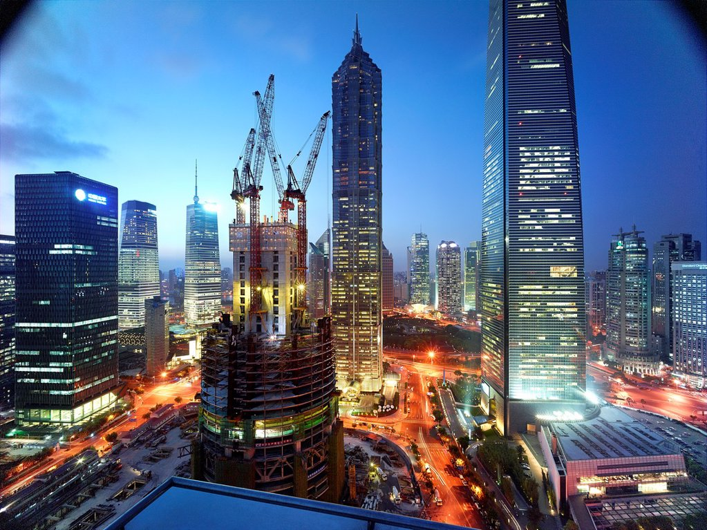 The construction of the Shanghai Tower in Shanghai, China next to the Shanghai World Financial Center and the Jin Mao Tower : Stock Photo