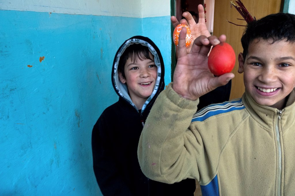 Stock Photo: 1566-1175220 A boy holds a painted egg given him during the Easter carol in the Gipsy ghetto of Chanov, Most, Czech Republic, 26 March 2008