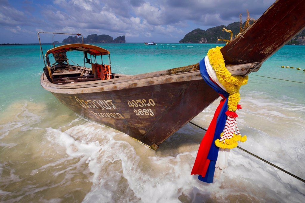Stock Photo: 1566-1175979 Longtail boat on Long beach  Phi Phi Don island  Krabi province, Andaman Sea, Thailand