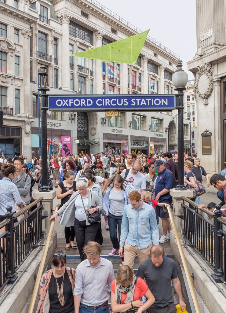 Oxford Circus underground entrance with crowds of people going down the stairs to station, London, England : Stock Photo