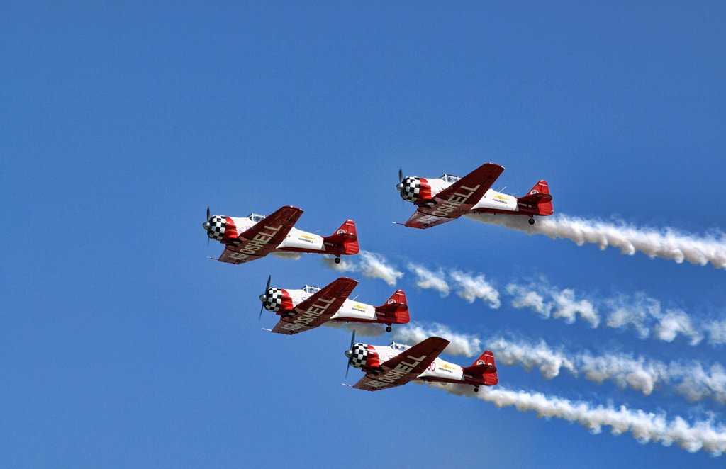 The Aeroshell demonstration team soars overhead in the blue skies of the Dayton Airshow : Stock Photo