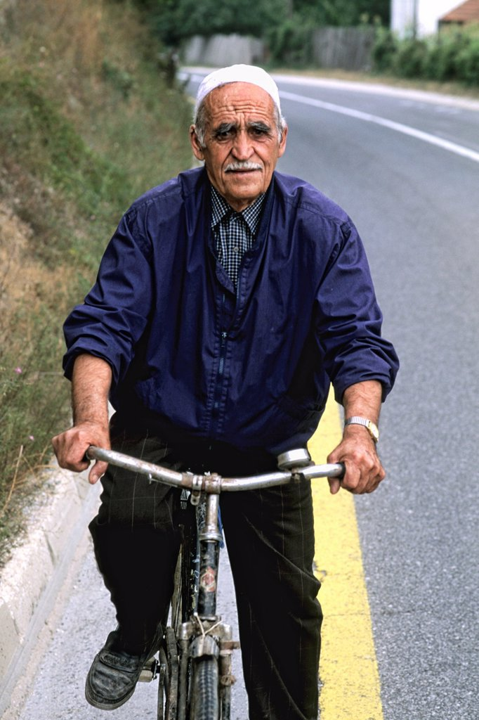 Man on bicycle in Albania near Tirana : Stock Photo