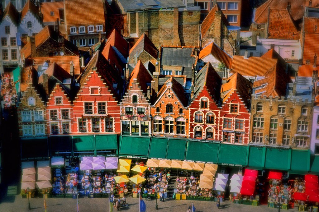 Belgium Market Place in center cafes taken from Belfort 337 steps above center the colorful city of Bruges : Stock Photo