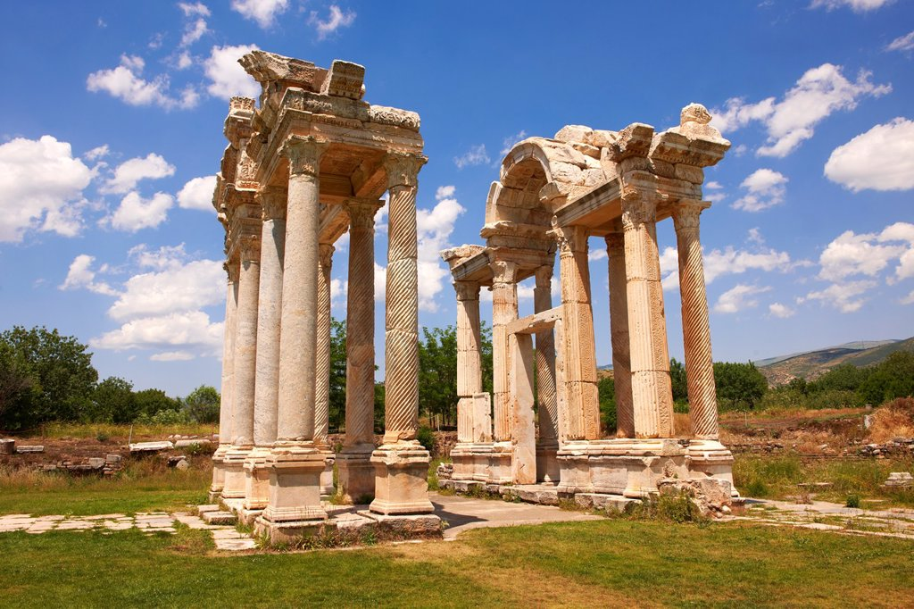 Stock Photo: 1566-1177902 Picture of the double Tetrapylon Gate, Aphrodisias, Turkey. A tetrapylon Greek: ?et??p????, ´four gates´ is an ancient type of Roman monument of cubic shape, with a gate on each of the four sides: generally it was built on a crossroads. stock photos & pho. Picture of the double Tetrapylon Gate, Aphrodisias, Turkey. A tetrapylon Greek: ?et??p????, ´four gates´ is an ancient type of Roman monument of cubic shape, with a gate on each of the four sides: generally it was built on a crossroads. stock