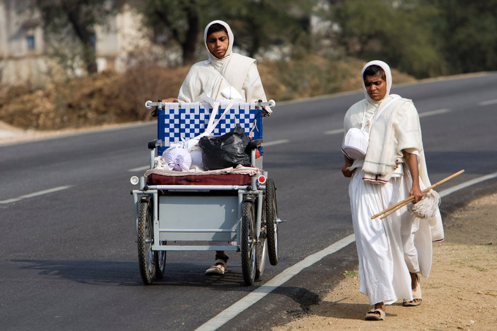 Stock Photo: 1566-1177978 Jain women pilgrim saddhu walking from temple to temple near Diver Rajasthan India
