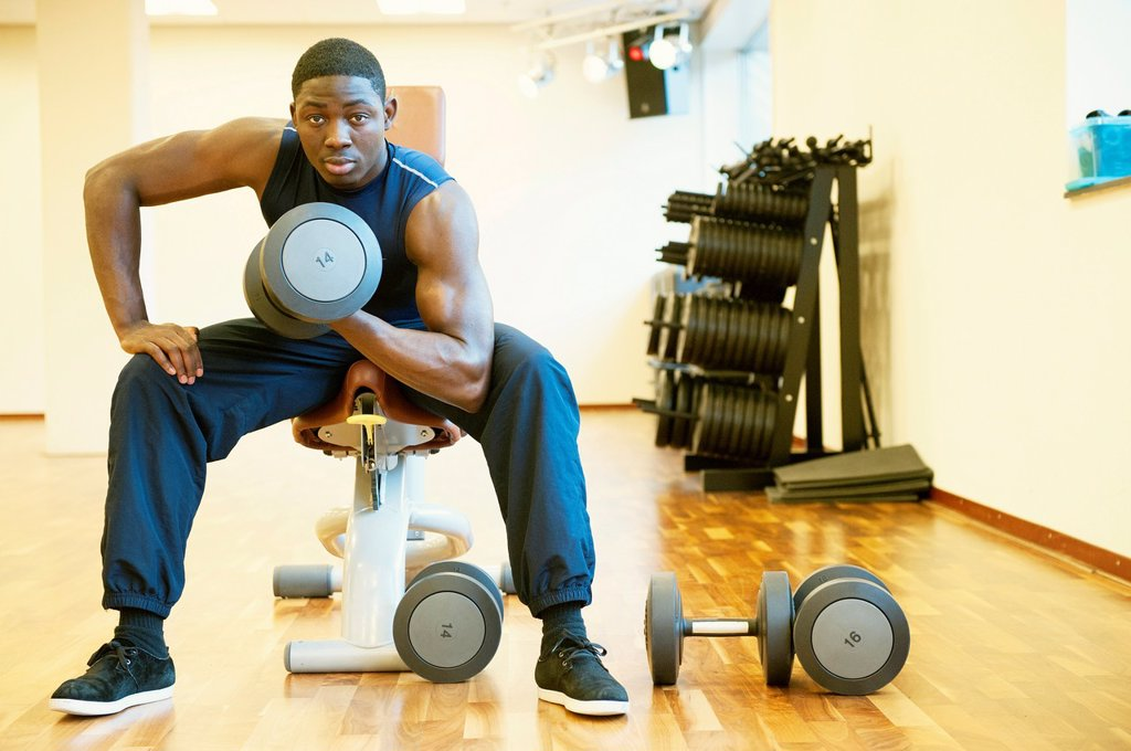 Tilburg, Netherlands  Young African-American man working out in the gym : Stock Photo