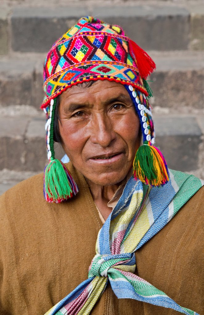 Local religious Shaman in traditional religious clothes in Cusco Cuzco Peru : Stock Photo