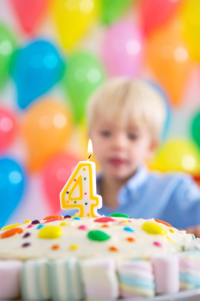 Four year old boy celebrating his birthday : Stock Photo