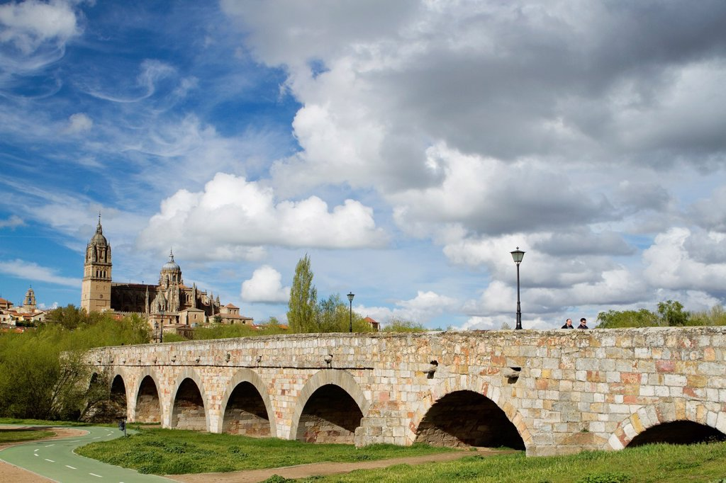 Stock Photo: 1566-1179716 Overview of the cathedrals of Salamanca from Roman Bridge over the Tormes river  Salamanca  Castilla y Leon  Spain