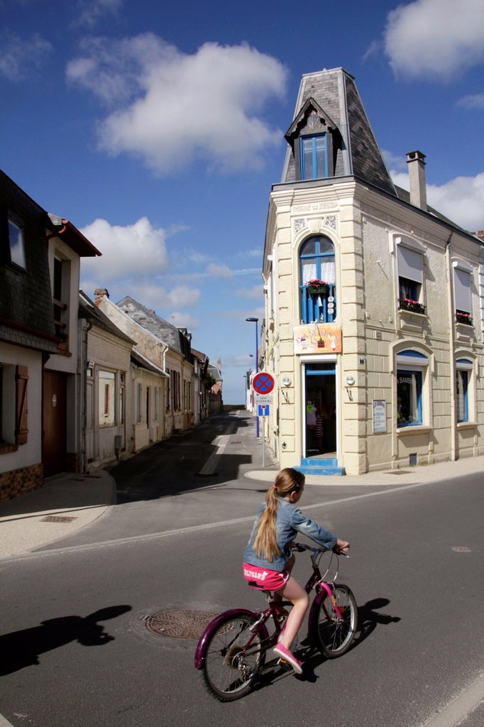 person riding bike in crotoy france : Stock Photo